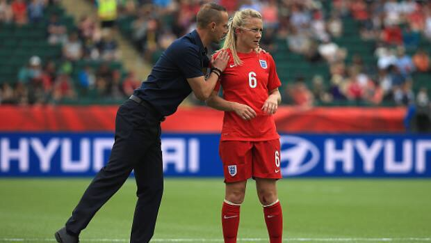 Mark Sampson is very proud standing with Laura Basset who has said to have been in agony both emotionally and physically after scoring an own goal in the semi final against Japan.