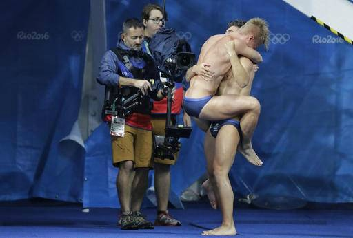 Chris Mears 23, and Jack Laugher21 jump for joy