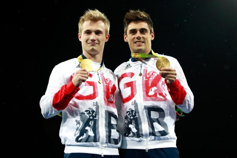 Both divers pose with their new Olympic Gold medals