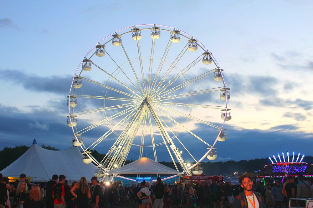 The iconic ferris wheel lights up the evening sky across Leeds Festival ( Image Sean Brown)