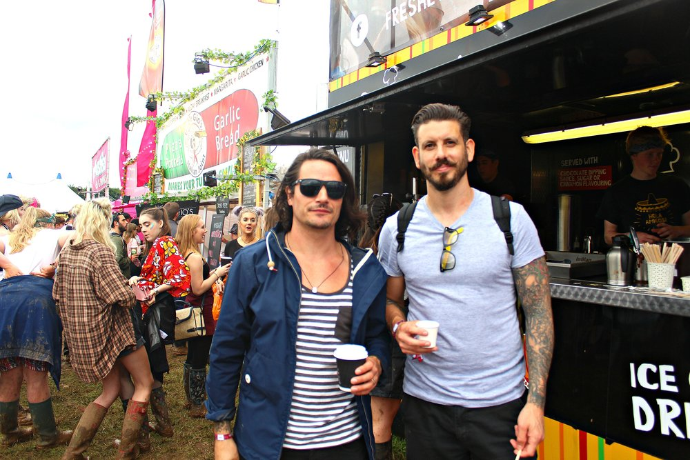 Two revellers enjoy a morning coffee before the days events ( Image Sean Brown)