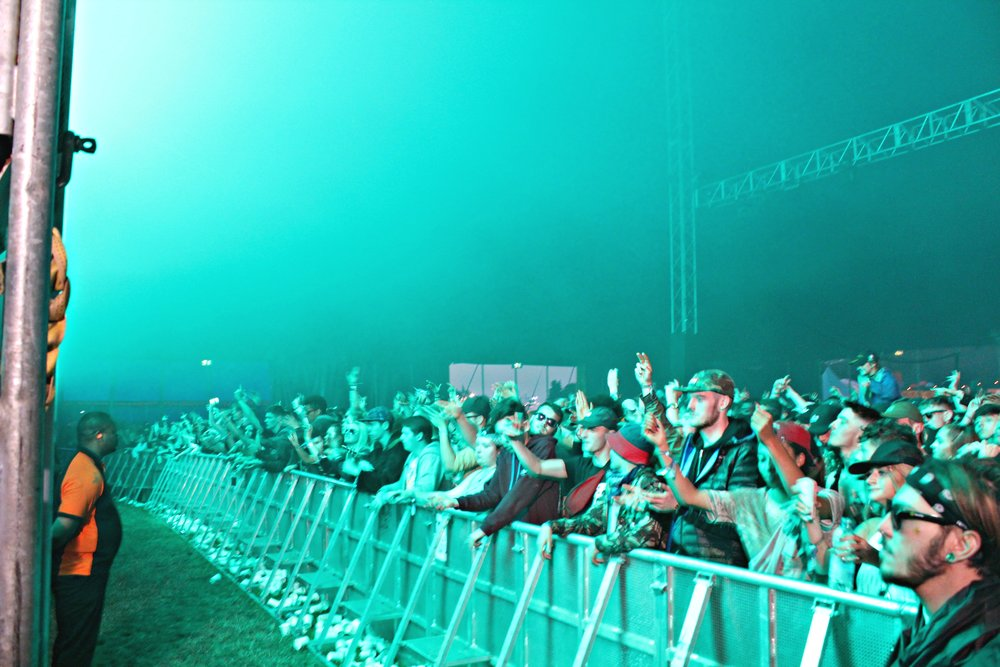 Fans enjoy the lightshow during Baauer
