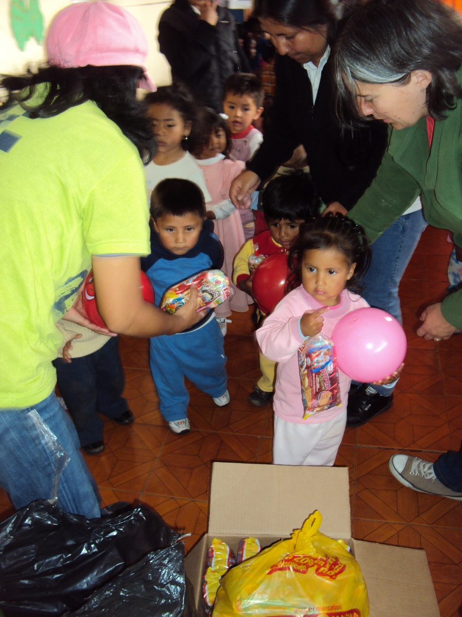 Delfin handing out gifts.jpg