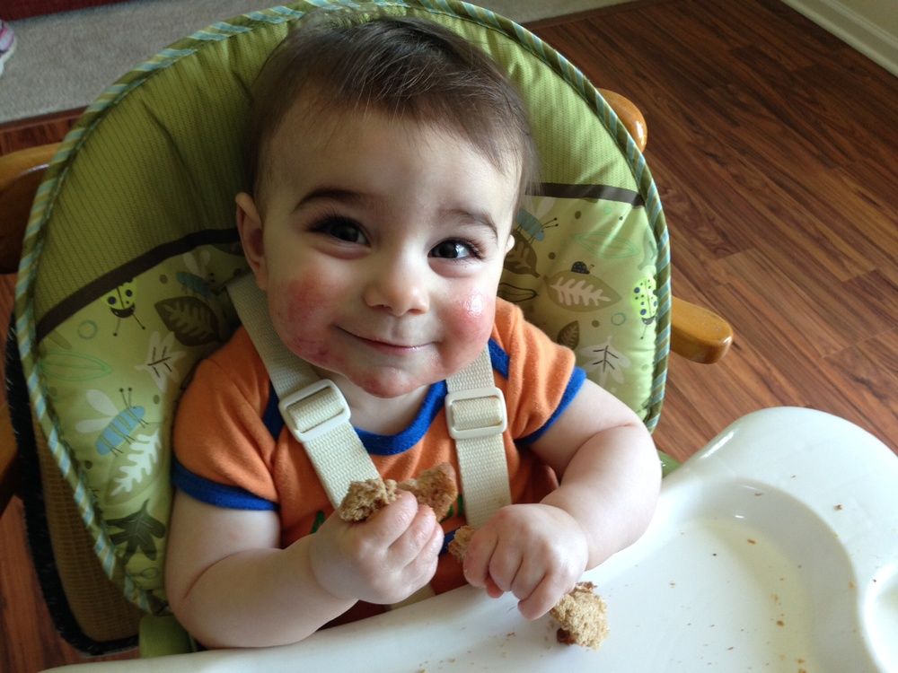 Henry trying Peanut Butter (good stuff!) for the first time a couple of weeks ago.