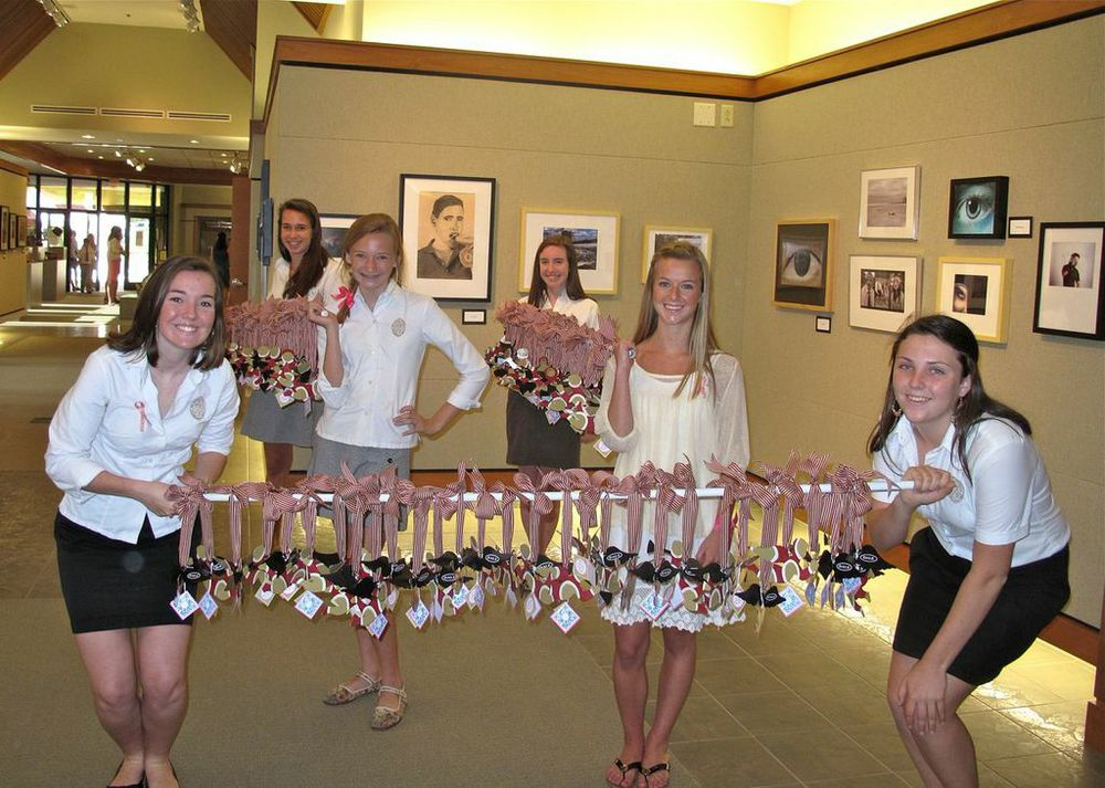 The Episcopal School of Jacksonville's Wings club presents over 200 angels to the entire faculty and staff made in memory of Dale Regan.