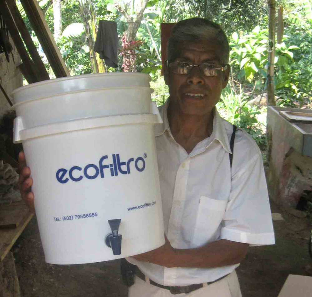 Gavino holding his new water filter.