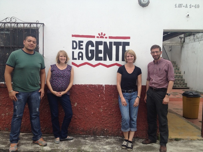 The DLG staff in front of the new sign.