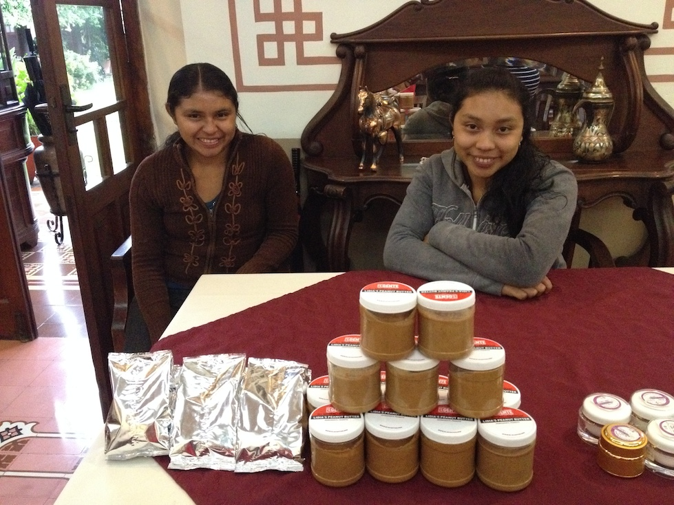 Lilian and Lidia are all set up with their bags of roasted peanuts and homemade (and delicious) peanut butter.