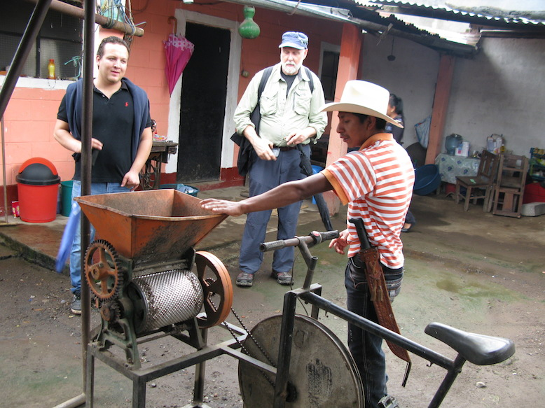 Carlos shows off the pulpador, which removes the fleshy outer layer of the coffee fruits and separates out the bean.