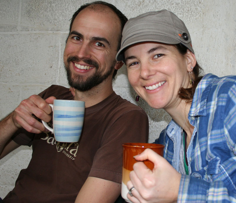 Les and Jamie from Deeper Roots Coffee enjoying coffee at a farmer's house in Huehuetenango.