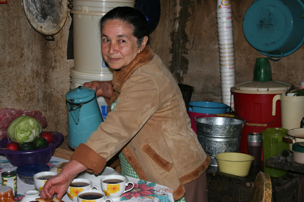 Woman farmer pouring coffee.JPG
