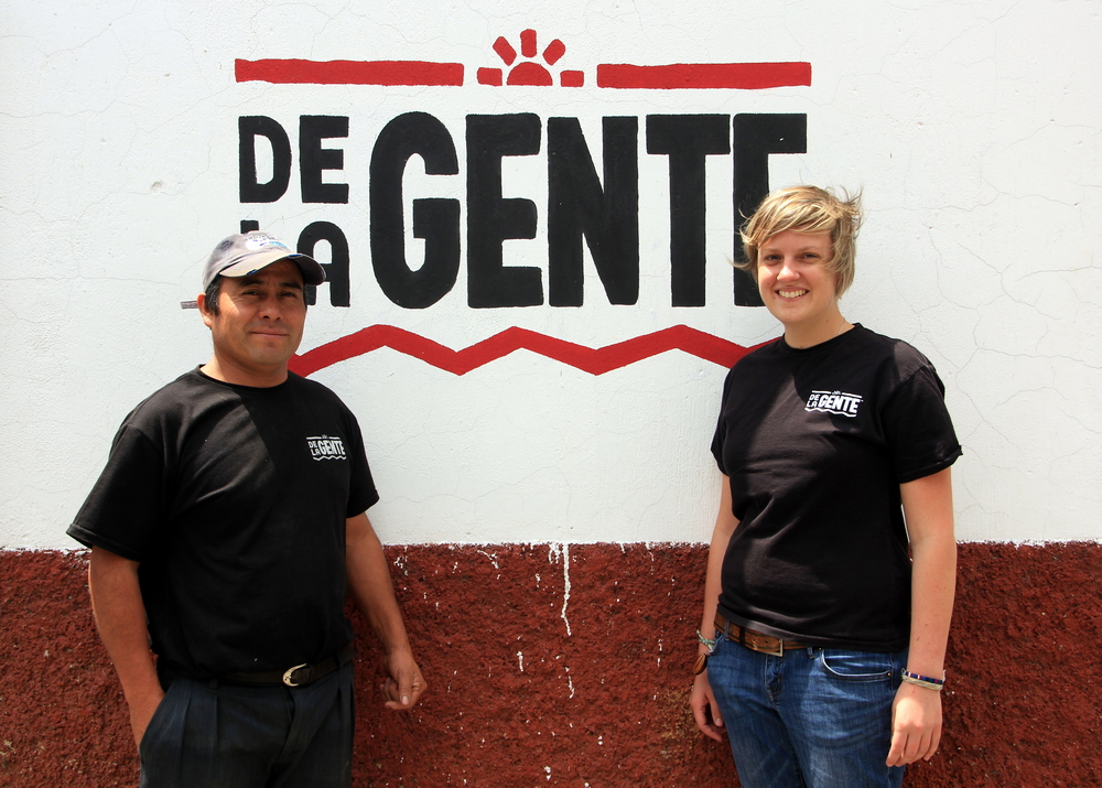 Froilan and Beth outside the De la Gente office