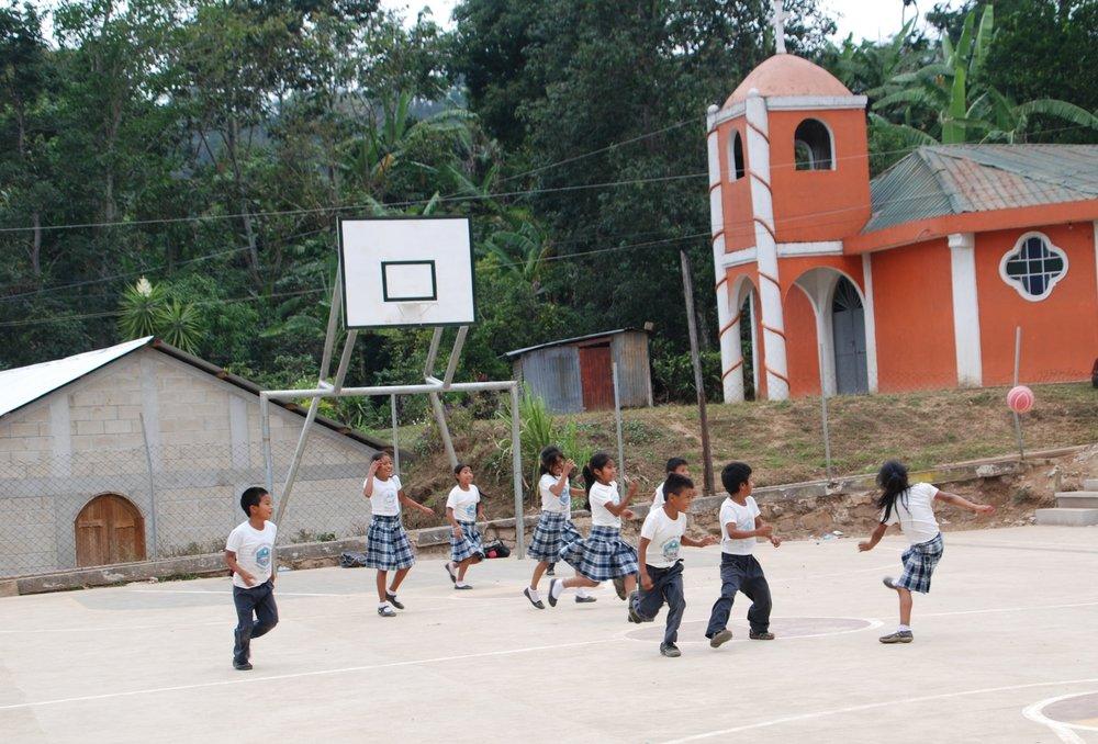 Children enjoying a game of soccer.