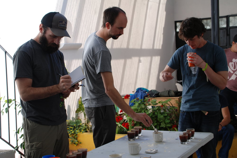 Rob Hoos, Les Stoneham and David Wilson cupping microlots at De la Gente's office in February 2018