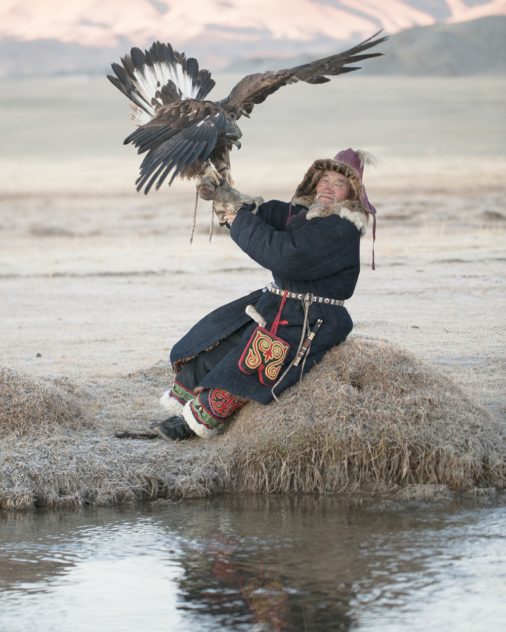 elderly kazakh eagle hunter posing with golden eagle 2.jpg