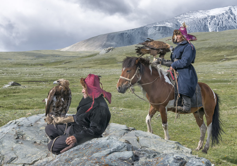 Mongolian Kazakh Eagle Hunters in the mountains.jpg