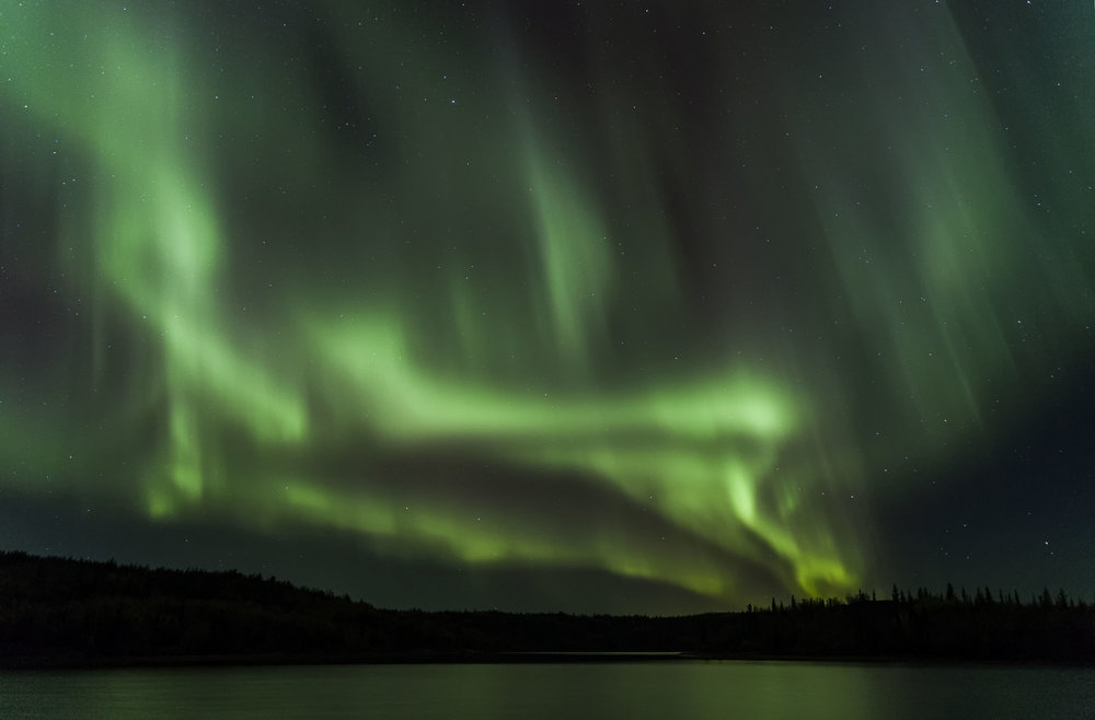 northern lights rain from the sky during on of kevin peppers photo workshops in canada