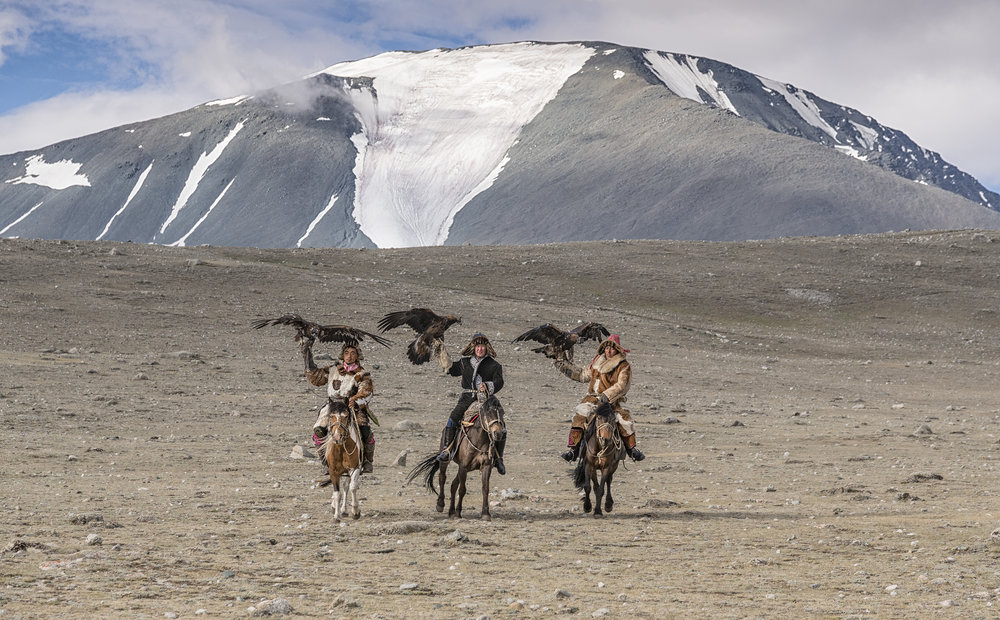 three eagle hunters on horseback.jpg
