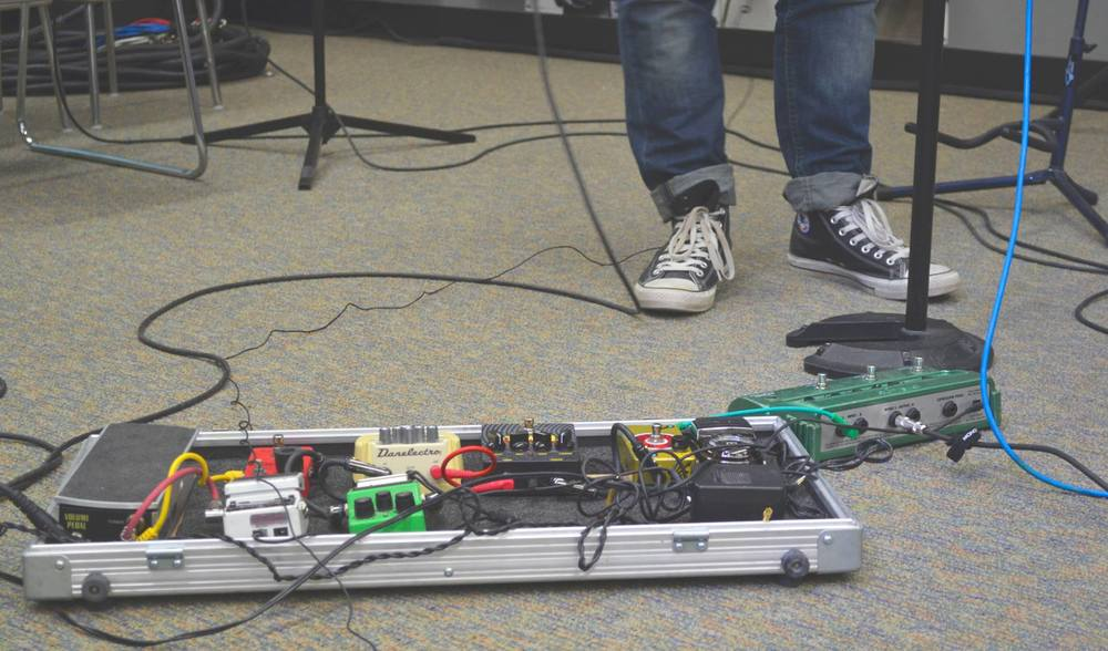 A bundle of distortion pedals used during a jam session