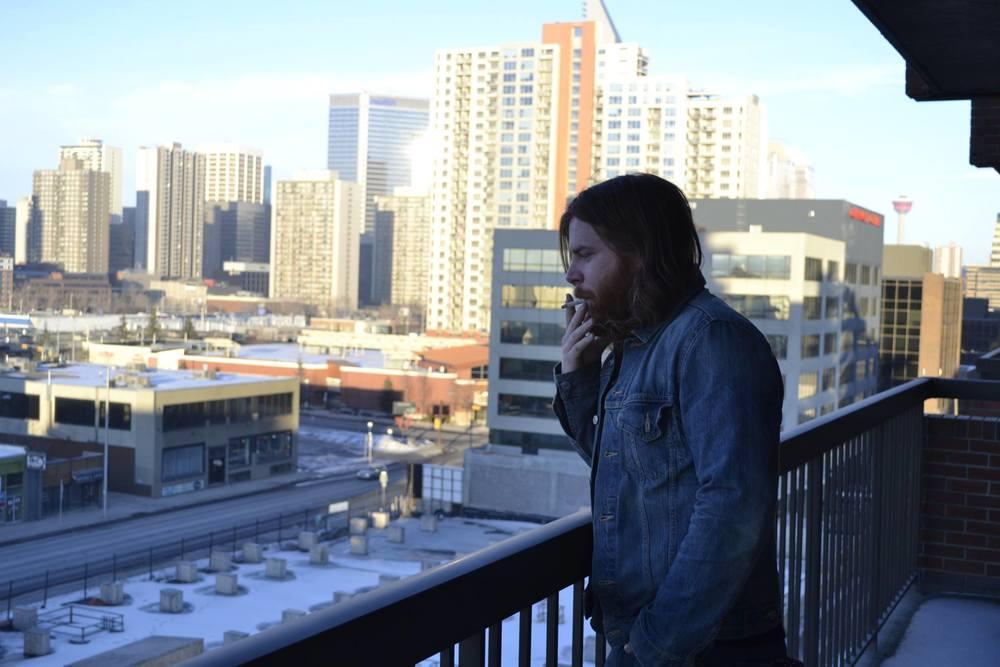 J.J. Shiplett smokes atop his downtown balcony