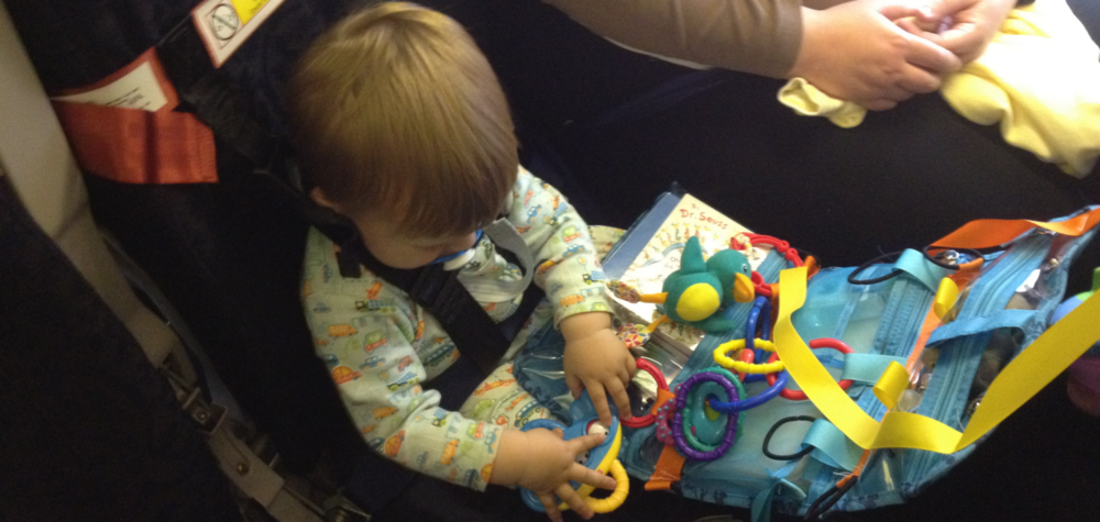 Bambino hard at work with his travel organizer.