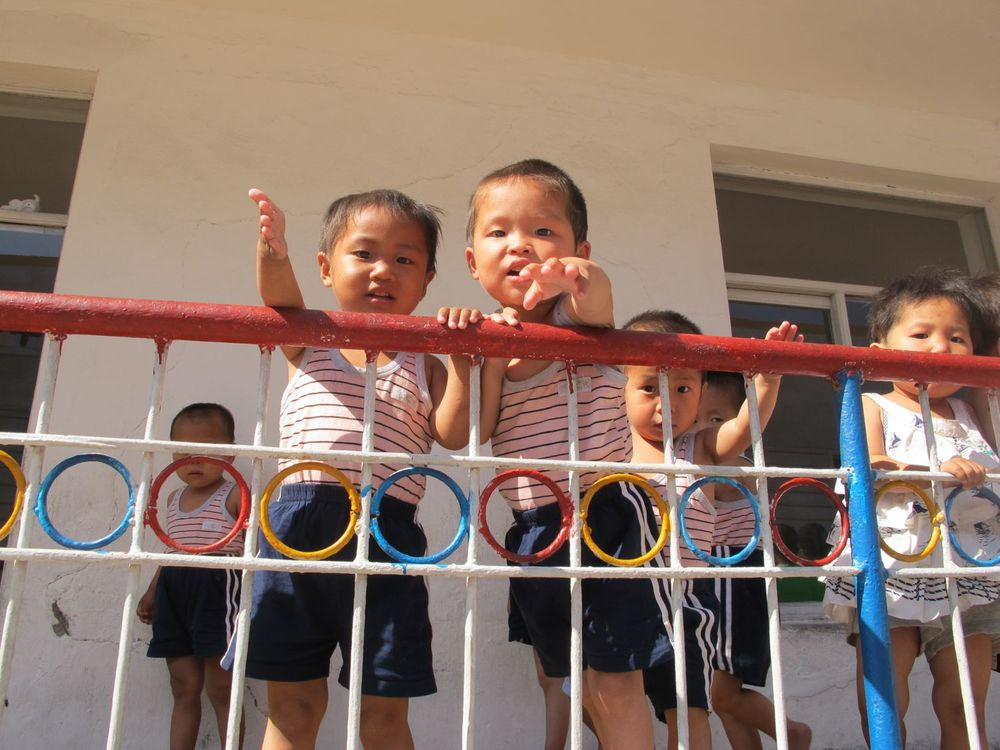 Orphans in the Pyongsong Orphanage bid farewell to our team who installed a solar water heater on their roof - for improved health and hygiene.