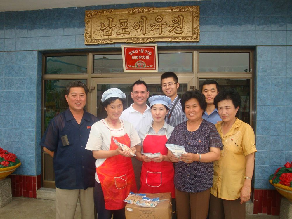 Donating Mannapack food packages to the Pyongsong Orphanage.