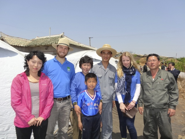 Shelterbox team members inspect deployment of Shelterbox tents in Rakrang district of Pyongyang, June 2015