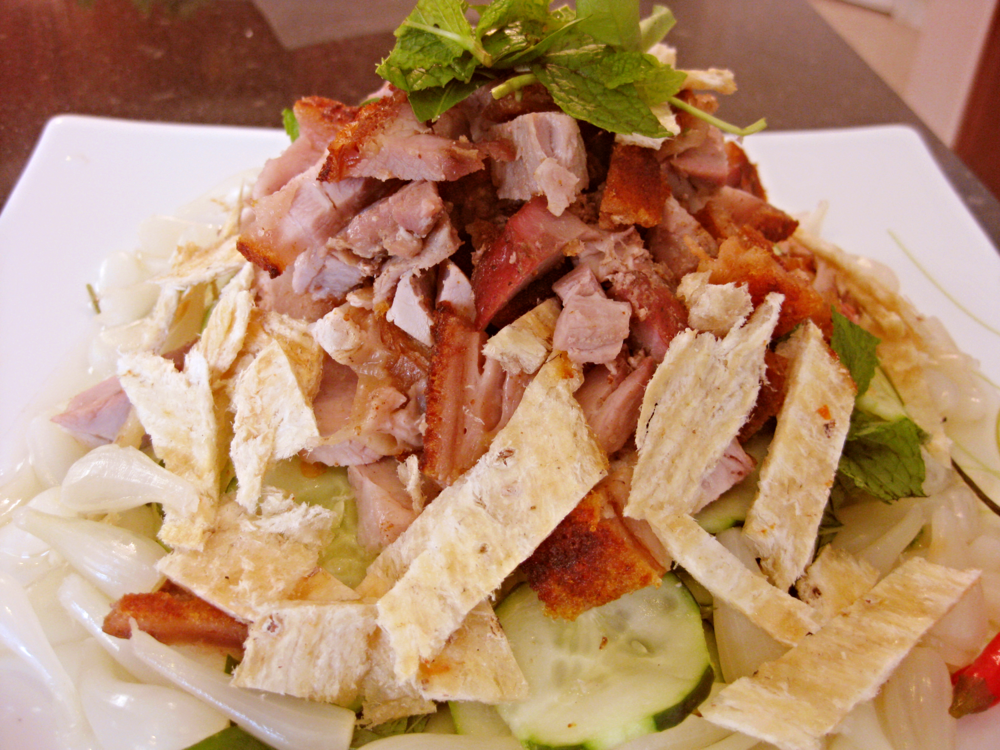 The crispy pork and dried fish are the stars of this dish.