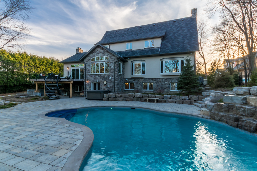 Stone patios, custom pool and waterfall