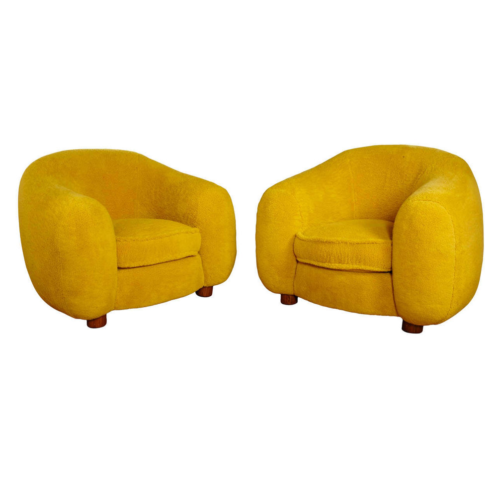 pair of yellow chairs by jean royere