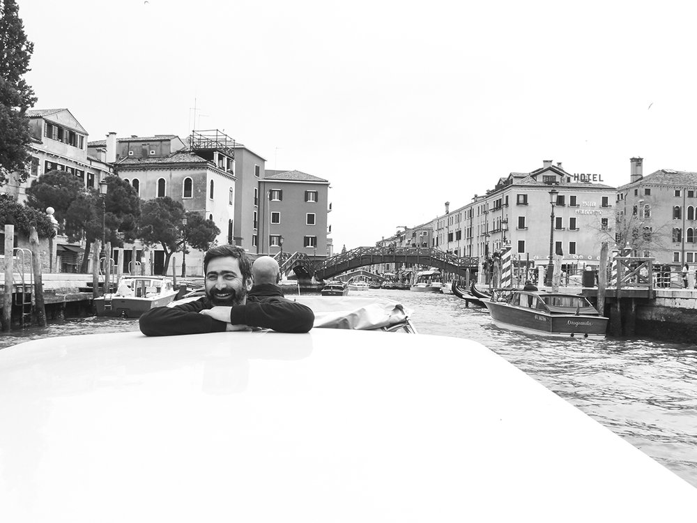 Travelling at night, living in the daytime, the world is here, where we are now, sharing a boat taxi with Yuri Ancarani on our way to enjoy a breakfast at Cafe' Florian in Venice.