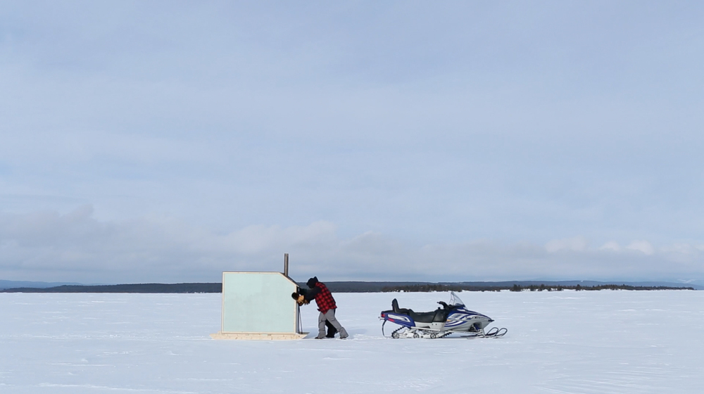 Jordan Bennett. V  ideo still from  Ice Fishing,  2014  .    In collaboration with National Film Board of Canada and imagineNATIVE.  Videographer: Dru Kennedy