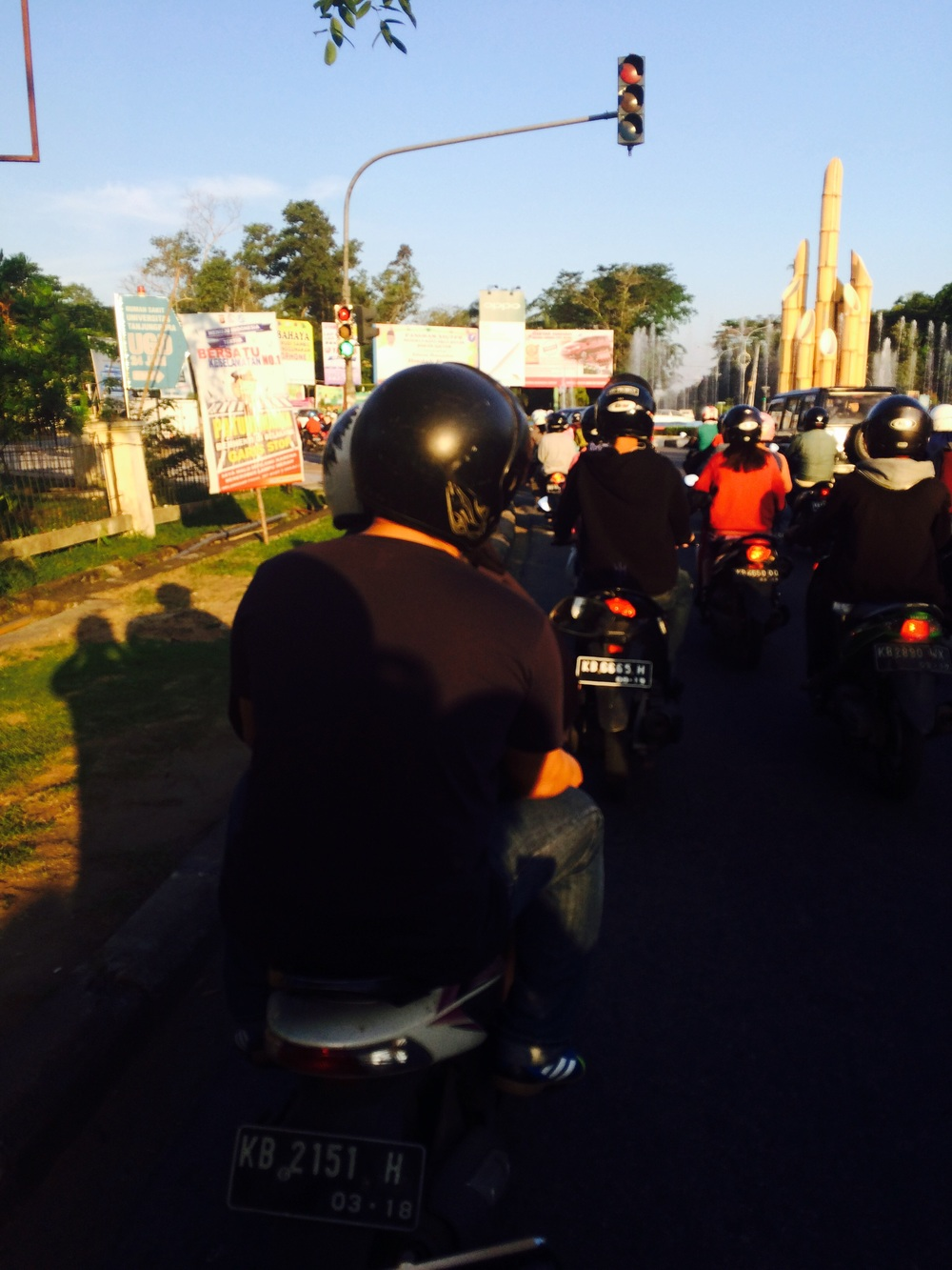 Pontianak rush hour with multitudes of motorbikes.
