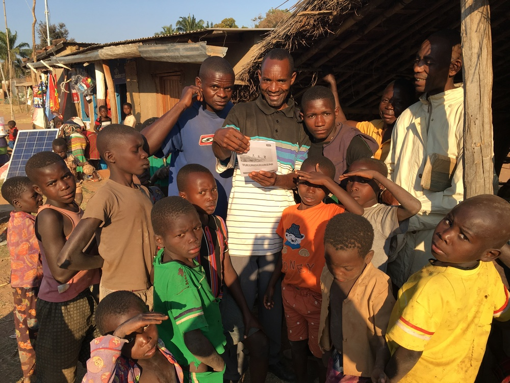 Moise distributing the Tulundulukeni teaching magazine