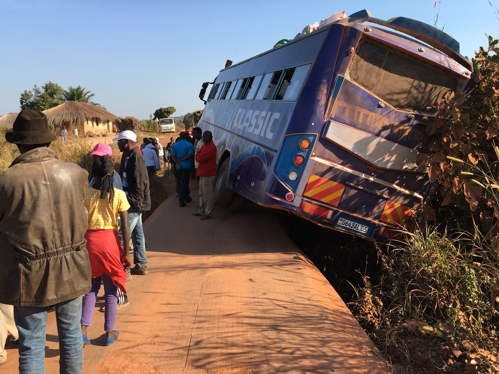 A bus blocking a narrow bridge rebuilt since the war