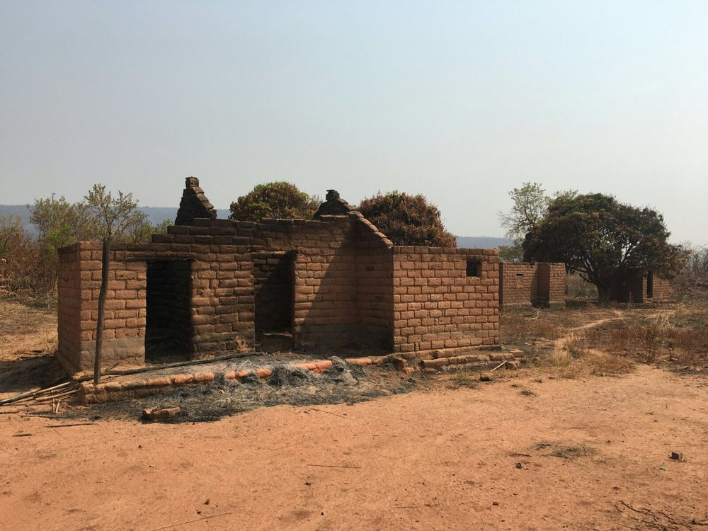 Houses burned by mai mai rebels.
