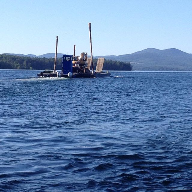 Winds have finally subsided (kinda) and (broad side) island work can recommence #barge #rattlesnakeisland #lakewinnipesaukee #cat311 #pushboat #altonnh #laconianh #meredithnh