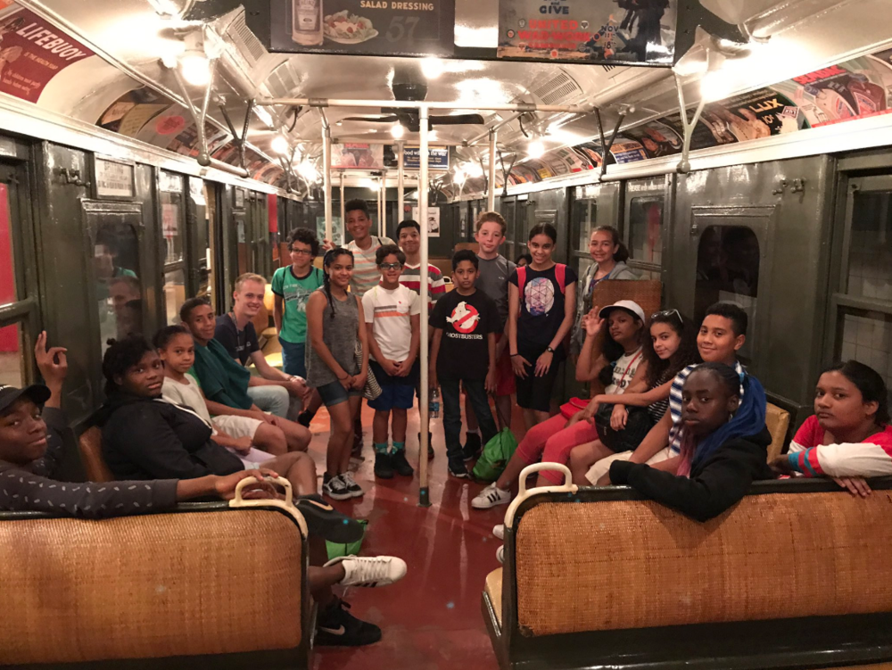 ACP MS went to the NYC Transit Museum. Here's a photo of us on a 100+ year old train cart.