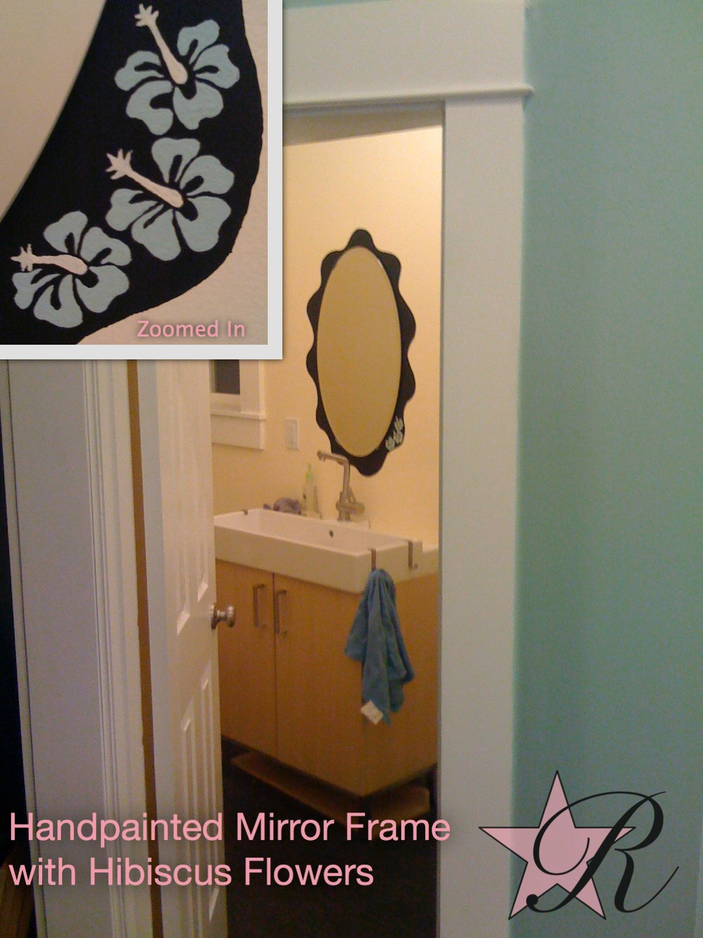 While painting the interior of this house, Rockstar Remodel gave the bathroom mirror a hand-painted frame with hibiscus flowers matching the wall paint on the lower righthand corner.