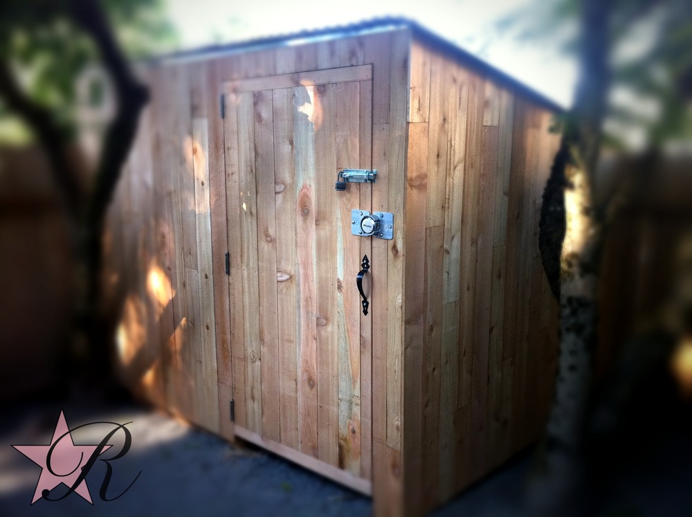 Rockstar Remodel built a custom garden shed that blends in with the existing fence.