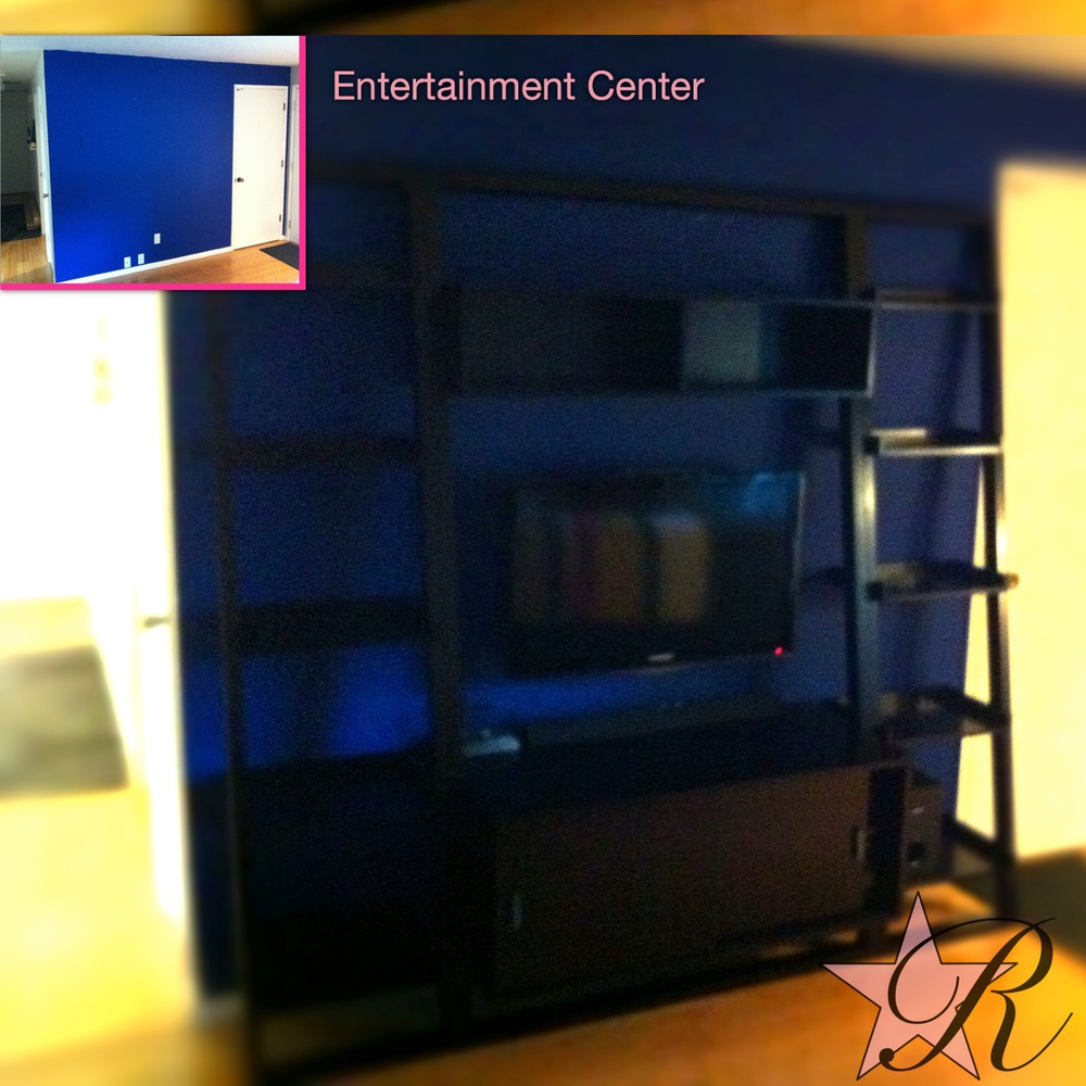 This entertainment center was pre-fabricated. Rockstar Remodel assembled it and secured it to the wall along with the wall mounted TV.