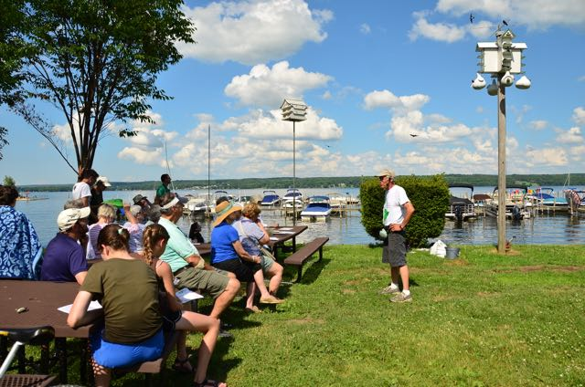 A crowd gathers lakeside every Friday at 4pm for a Purple Martin Chat