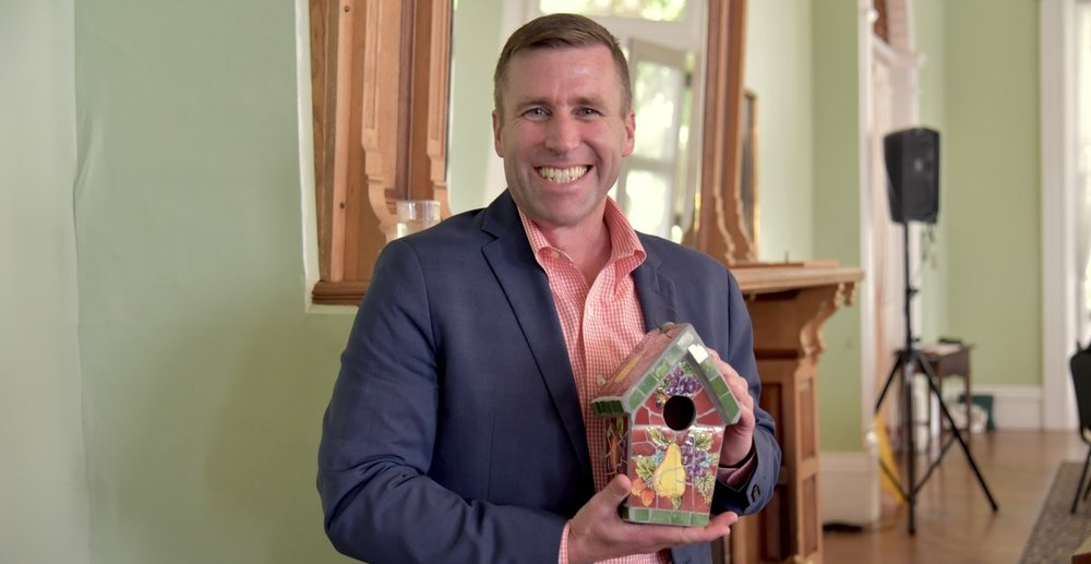 Institution President Michael Hill receives a bird house from BTG!