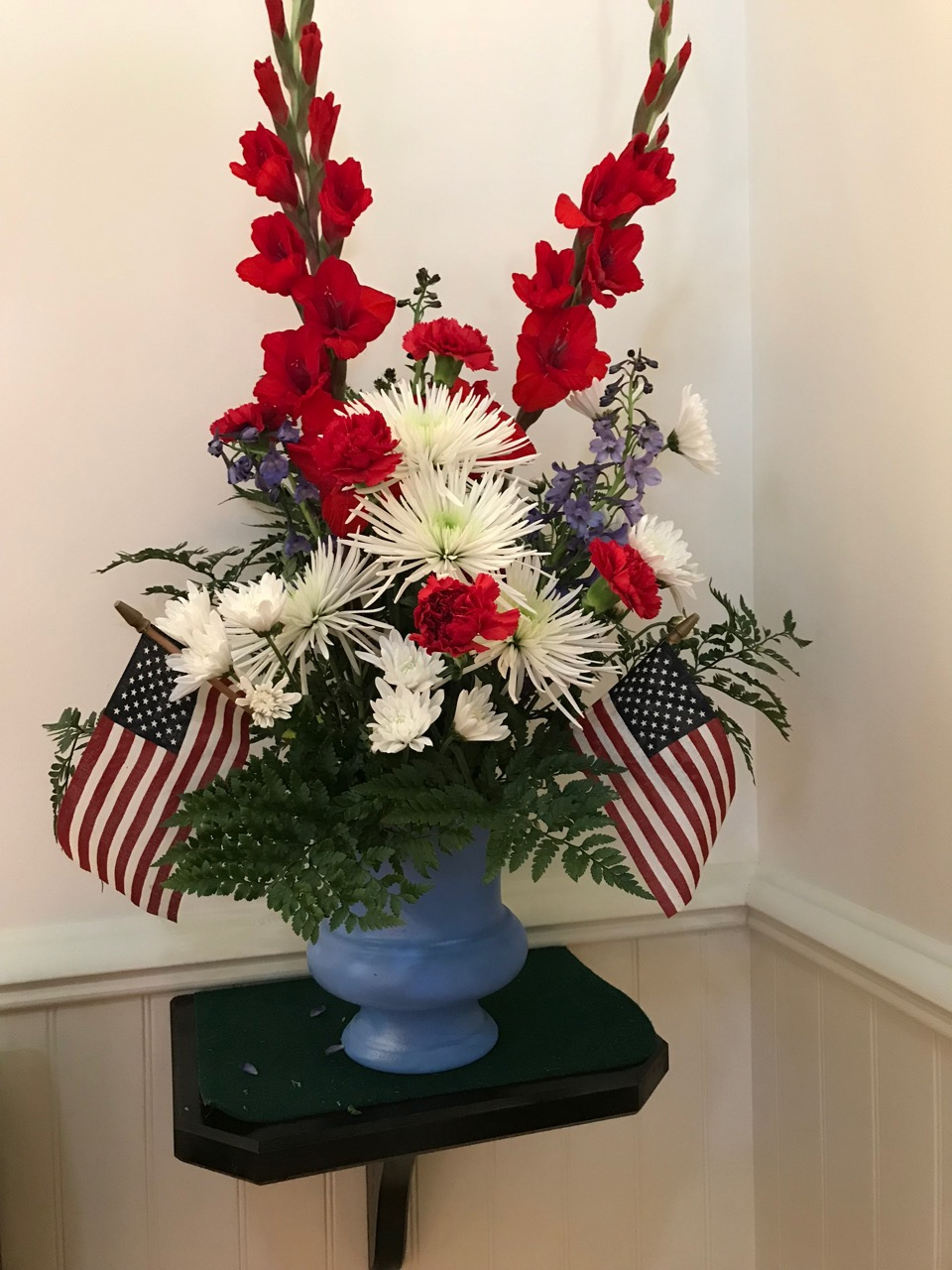 Patriotic July 4 pair of arrangements on the altar for Independence Day