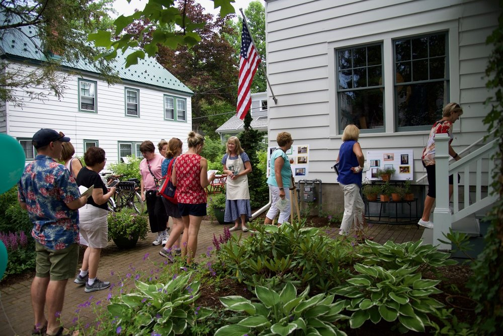 Head hostess welcomes visitors to the colorful eclectic Benson Cottage