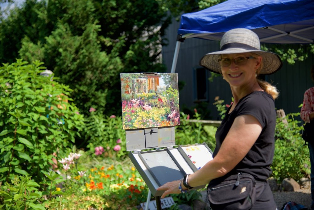 Local artist creating a rendering of a private garden on site