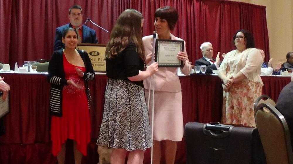 Stephanie Martin accepting her scholarhsip