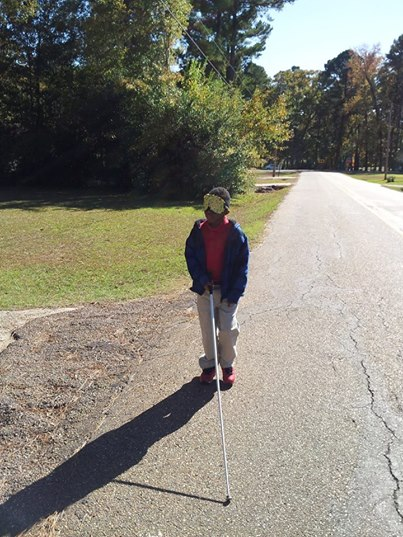 Braylon travels through Ruston undersleeps with his long, white cane