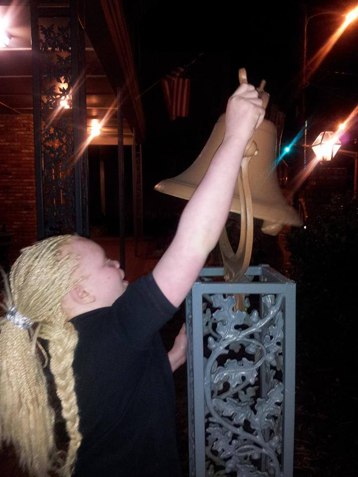 Rekendra rings the LCB Freedom Bell to celebrate a success